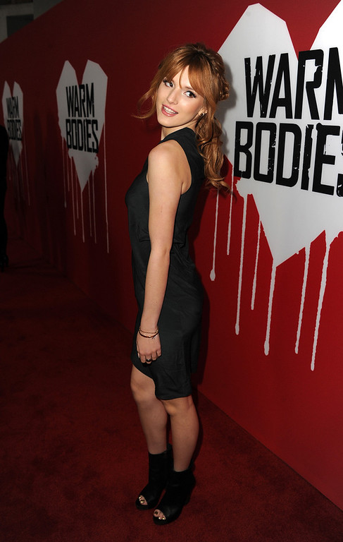 ". Actress Bella Thorne arrives for the Los Angeles premiere of Summit Entertainment\'s ""Warm Bodies\"" at ArcLight Cinemas Cinerama Dome on January 29, 2013 in Hollywood, California.  (Photo by Kevin Winter/Getty Images)"