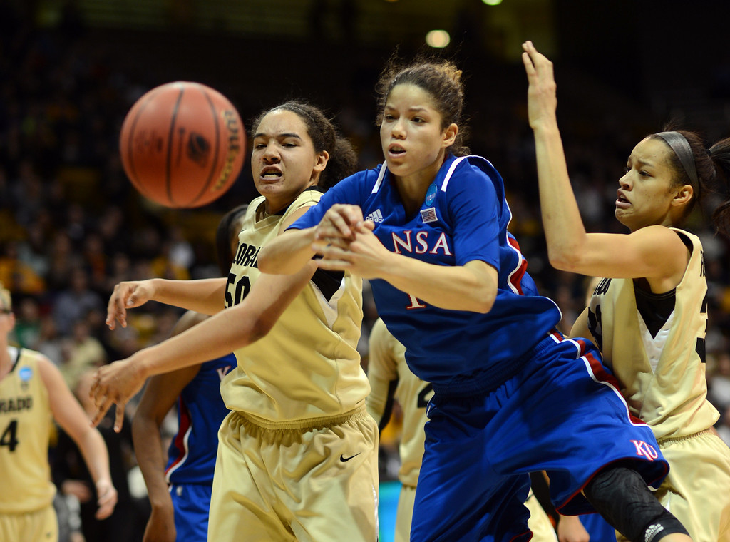 . BOULDER, CO. - MARCH 23: Jamee Swan of Colorado Buffaloes (50), left, and Monica Engelman of  Kansas Jayhawks (13) are fighting for the free ball by Arielle Roberson (32) of Baffaleis, right, during the first round of the 2013 NCAA women\'s Basketball Tournament at Coors Events Center. Boulder, Colorado. March 23, 2013. Kansas won 67-52. (Photo By Hyoung Chang/The Denver Post)