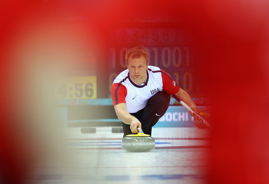 . SOCHI, RUSSIA - FEBRUARY 13:   Jeff Isaacson of USA in action during the Curling Round Robin match between USA and Great Britain during day six of the Sochi 2014 Winter Olympics at Ice Cube Curling Center on February 13, 2014 in Sochi, Russia.  (Photo by Julian Finney/Getty Images)