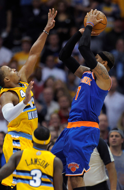 . Carmelo Anthony launched the last shot of the game over Denver guard Randy Foye to put the game into overtime. It did not go in.    Photo By Karl Gehring/The Denver Post
