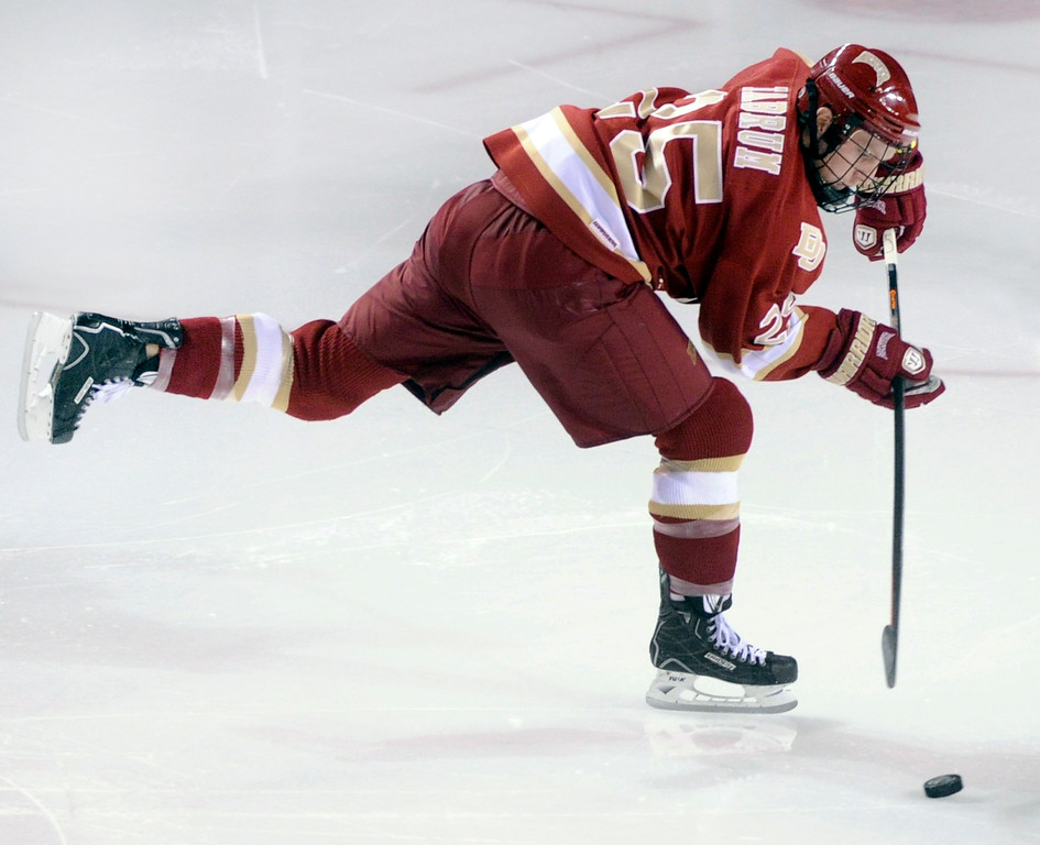 . DENVER, CO. - OCTOBER 25: Denver wing Matt Tabrum skated with the puck in the second period. The University of Denver hockey team hosted Niagara at Magness Arena Friday night, October 25, 2013. Photo By Karl Gehring/The Denver Post