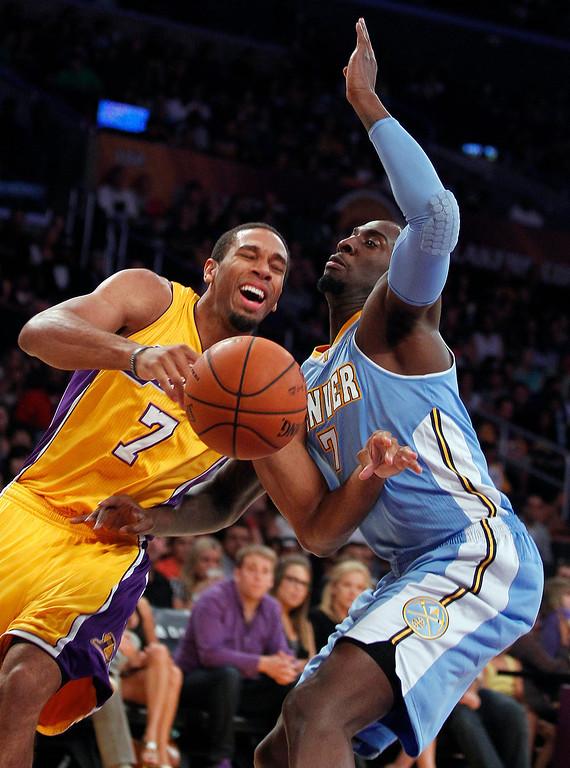 . Los Angeles Lakers guard Xavier Henry, left, has the ball knocked away by Denver Nuggets forward J.J. Hickson during an NBA preseason basketball game Sunday, Oct. 6, 2013 in Los Angeles. (AP Photo/Alex Gallardo)