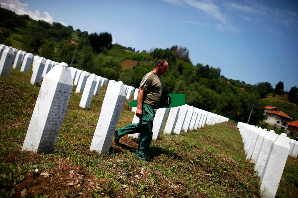. A Bosnian worker walks to prepare graves for 409 coffins of newly identified victims of the 1995 Srebrenica massacre in Memorial Center Potocari near Srebrenica July 10, 2013. The bodies of the recently identified victims will be transported to the memorial centre in Potocari where they will be buried on July 11 marking the 18th anniversary of the massacre in which Bosnian Serb forces commanded by Ratko Mladic killed up to 8,000 Muslim men and boys and buried them in mass graves. REUTERS/Dado Ruvic