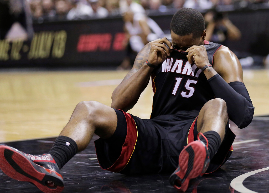 . Miami Heat guard Mario Chalmers (15) recovers after hitting the floor against the San Antonio Spurs during the first half in Game 2 of the NBA basketball finals on Sunday, June 8, 2014, in San Antonio. (AP Photo/Eric Gay)