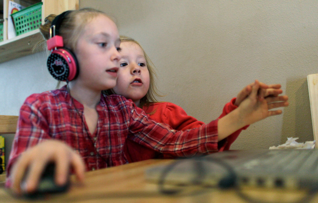 . In this Monday, Feb. 25, 2013, photo, Coy Mathis, right, plays on the computer at home in Fountain, Colo.  (AP Photo/Brennan Linsley)
