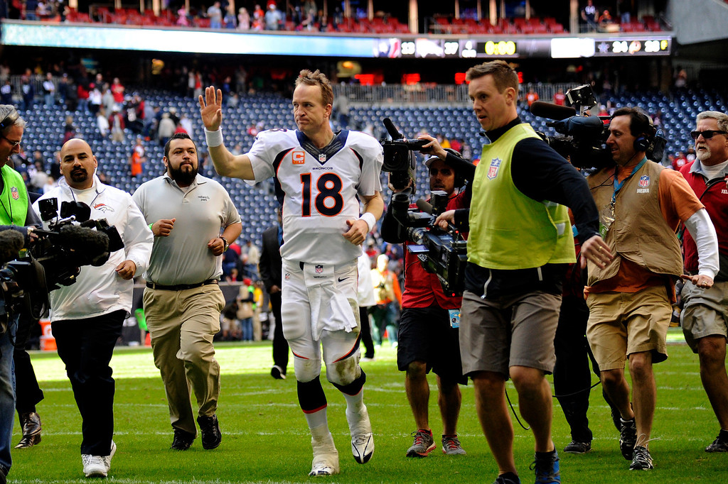 . HOUSTON, TX. - December 22: Quarterback Peyton Manning #18 of the Denver Broncos surrounded by media after winning against the Houston Texans at Reliant Stadium December 22, 2013 Houston, Texas. (Photo By Joe Amon/The Denver Post)