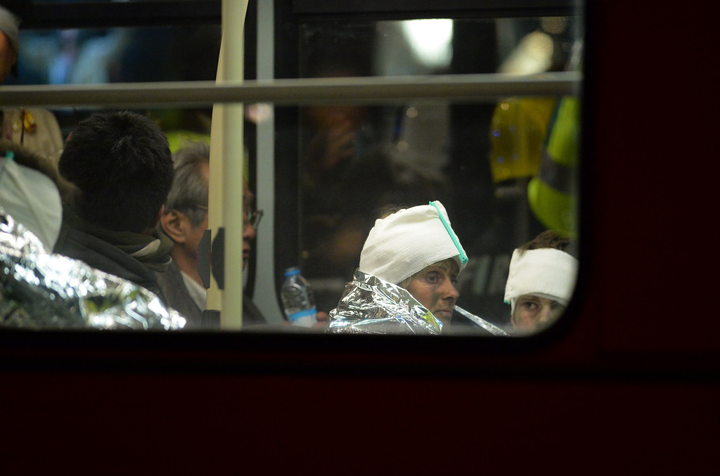 . Injured people sit wrapped in emergency blankets sit on a London bus used for casualties following a ceiling collapse at a theatre in Central London on December 19, 2013.    AFP PHOTO/LEON NEAL/AFP/Getty Images