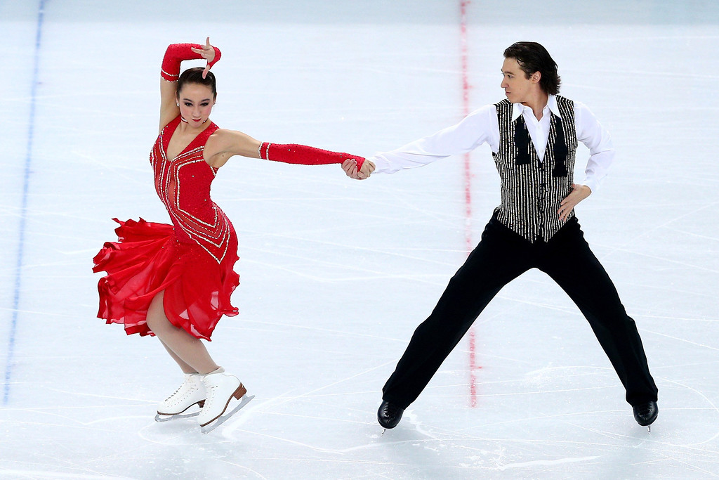 . Cathy Reed and Chris Reed of Japan compete during the Figure Skating Ice Dance Short Dance on day 9 of the Sochi 2014 Winter Olympics at Iceberg Skating Palace on February 16, 2014 in Sochi, Russia.  (Photo by Paul Gilham/Getty Images)
