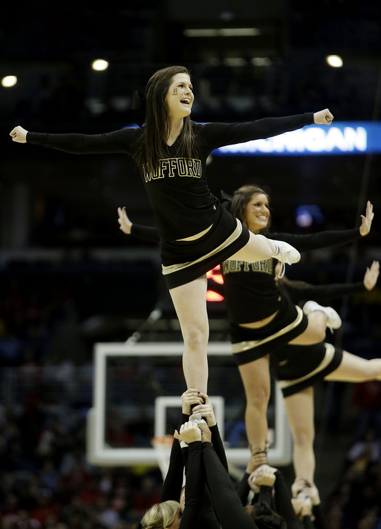 . The Wofford Terriers cheerleaders perform in the second half against the Michigan Wolverines during the second round of the 2014 NCAA Men\'s Basketball Tournament at BMO Harris Bradley Center on March 20, 2014 in Milwaukee, Wisconsin.  (Photo by Mike McGinnis/Getty Images)