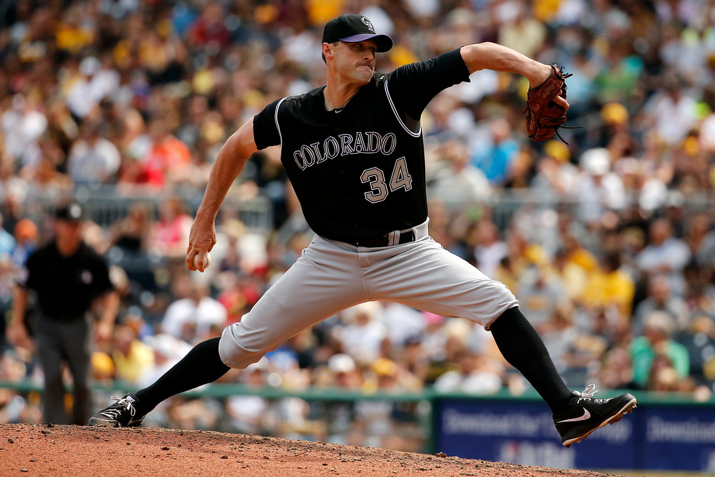 . Colorado Rockies relief pitcher Matt Belisle (34) throws against the Pittsburgh Pirates during the seventh inning of a baseball game in Pittsburgh Sunday, July 20, 2014. The Pirates won 5-3. (AP Photo/Gene J. Puskar)