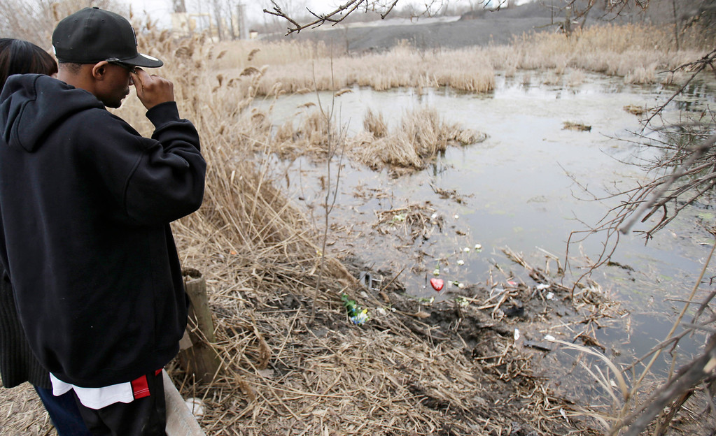 . Marquis Stephenson, 33, looks over the wreckage where six people died early Sunday in Warren, Ohio, on Monday, March 11, 2013. (AP Photo/Tony Dejak)