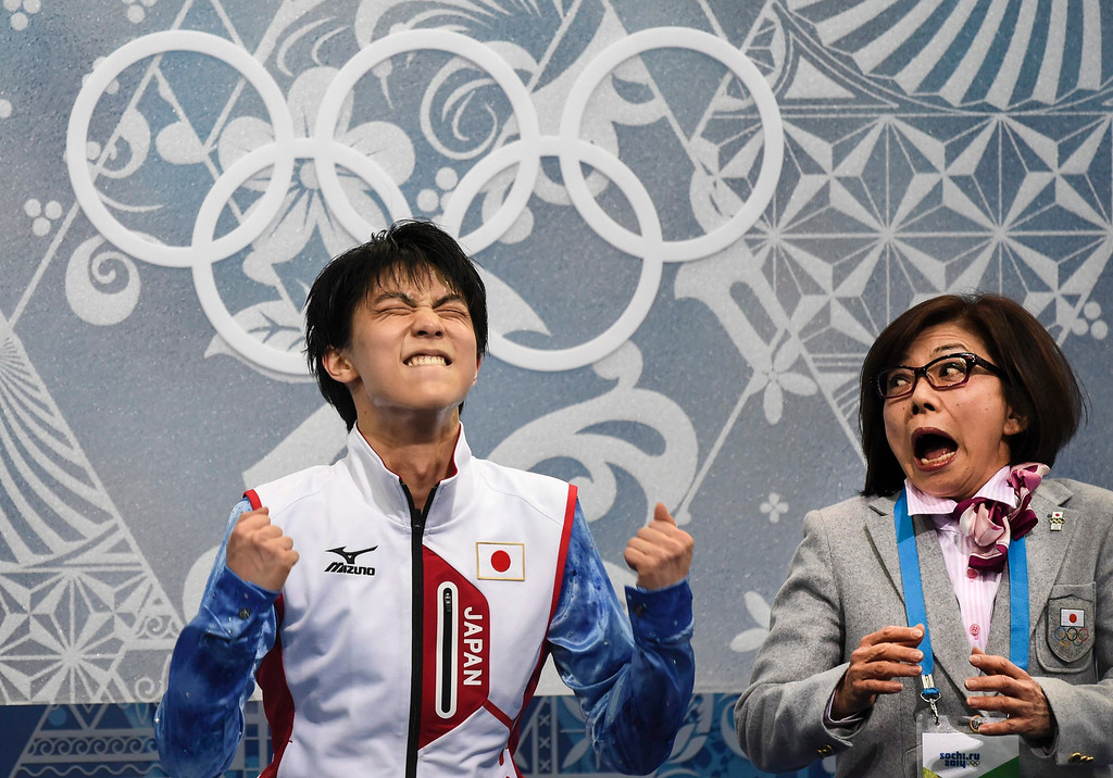 . Yuzuru Hanyu of Japan, reacts as he receives his results after competing in the men\'s short program figure skating competition at the Iceberg Skating Palace during the 2014 Winter Olympics, Thursday, Feb. 13, 2014, in Sochi, Russia. (AP Photo/The Canadian Press, Paul Chiasson)