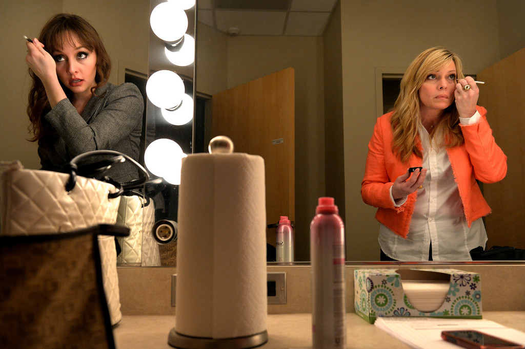 . AURORA, CO. - FEBRUARY 18: (l-r) Anchors Amanda Turner and Wendy Brockman prepare for the taping of Aurora News Weekly in Aurora, CO February 18, 2014. The 30 minute news show is part of Aurora 8\'s public access programming. (Photo By Craig F. Walker / The Denver Post)