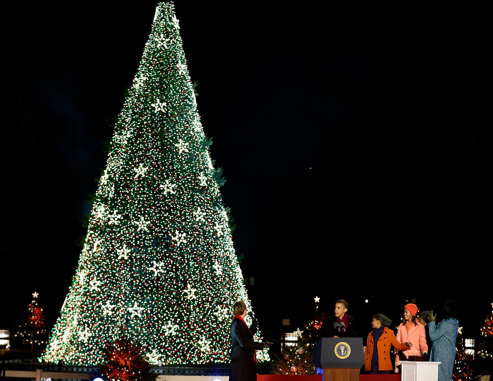 . President Barack Obama, first lady Michelle Obama, Malia Obama, Sasha Obama and Michelle Obama\'s mother Marian Robinson, participate in the 90th annual National Christmas Tree Lighting ceremony on the Ellipse south of the White House, Thursday, Dec. 6, 2012 in Washington. (AP Photo/Alex Brandon)