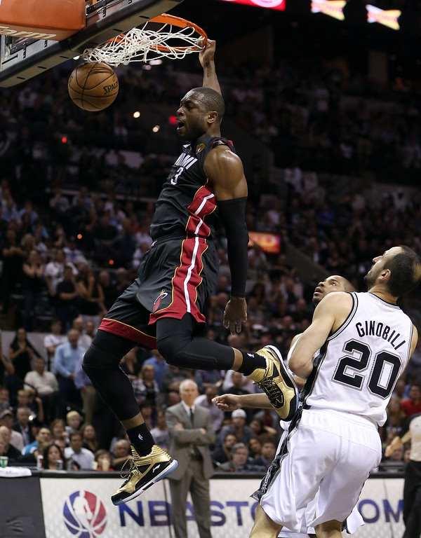 . Dwyane Wade #3 of the Miami Heat dunks the ball in front of Manu Ginobili #20 of the San Antonio Spurs in the fourth quarter during Game Four of the 2013 NBA Finals at the AT&T Center on June 13, 2013 in San Antonio, Texas.   (Photo by Christian Petersen/Getty Images)