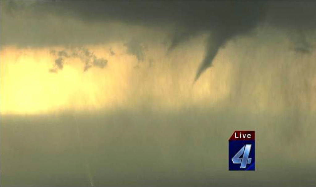 . An aerial image shows an active tornado over the skies of Harrah, Oklahoma May 19, 2013, in this still image provided by KFOR-TV. A tornado half a mile wide struck near Oklahoma City on Sunday, part of a massive storm front that hammered the central United States. News reports said at least one person had died. Courtesy of KFOR-TV/Handout via Reuters