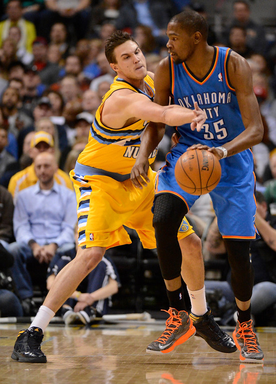 . DENVER, CO. - JANUARY 20: Denver Nuggets small forward Danilo Gallinari (8) reaches in on Oklahoma City Thunder small forward Kevin Durant (35) during the first quarter. The Denver Nuggets take on theOklahoma City Thunder in NBA action January 20,  2013 at Pepsi Center. (Photo By John Leyba / The Denver Post)