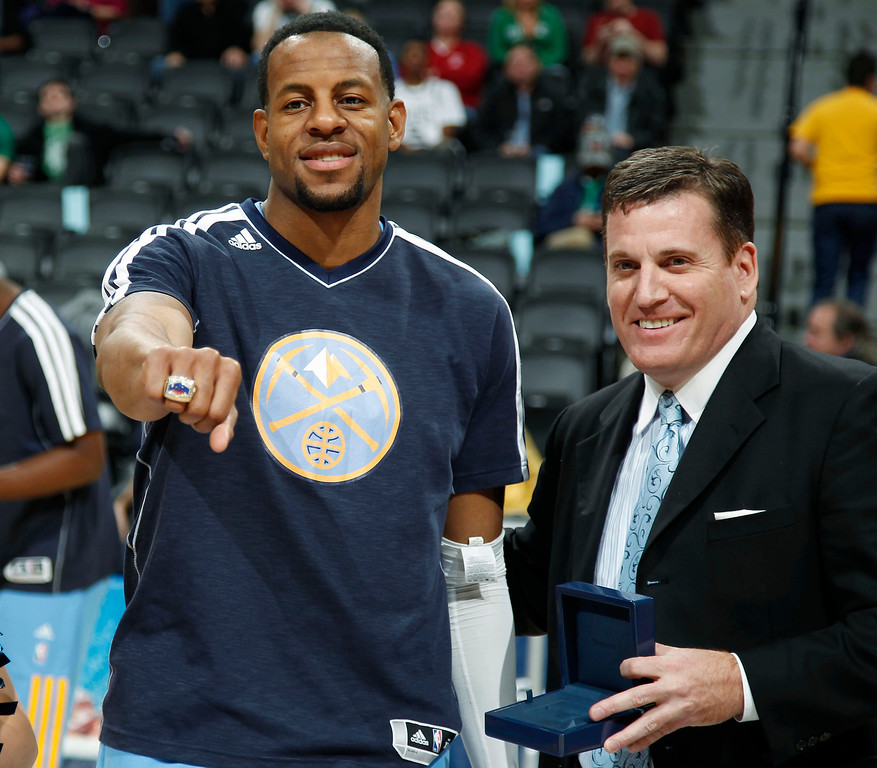 . Denver Nuggets guard Andre Iguodala  shows off his ring for being a member of the 2012 U.S. Olympic basketball team, after it was presented by Jim Tooley, executive director of USA Basketball, before the Nuggets played the Boston Celtics in an NBA basketball game in Denver on Tuesday, Feb. 19, 2013. (AP Photo/David Zalubowski)