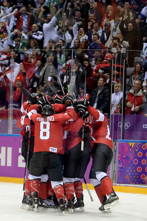. SOCHI, RUSSIA - FEBRUARY 20: Canada celebrates the game-winning goal by Marie-Philip Poulin (29) during the overtime period of Canada\'s 3-2 gold medal ice hockey win over the U.S.A. Sochi 2014 Winter Olympics on Thursday, February 20, 2014 at Bolshoy Ice Arena. (Photo by AAron Ontiveroz/ The Denver Post)