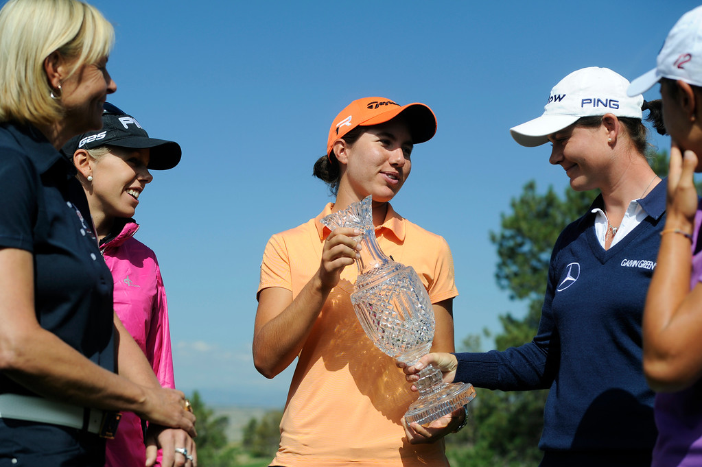 . European golfer, Carlota Ciganda, center, holds the 2013 Solheim Cup as fellow golfer, Caroline Masson, right from Masson, touches the crystal trophy at the Colorado Golf Club on media day in Parker Colorado, June 02, 2013. Solheim Cup captain, Liselotte, left, and European golfer, Pernilla Lindberg stand by and admire the trophy. (Photo By Andy Cross/The Denver Post)