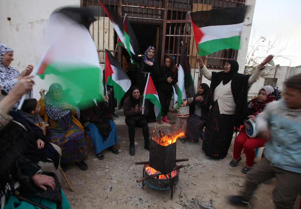 . Relatives and friends of Palestinian prisoner Said al-Tamimi celebrate after receiving the news of his impending release from an Israeli jail, in the West Bank village of Nabi Saleh, on December 29, 2013. Israel prepared today to free 26 Palestinian prisoners as part of peace talks brokered by US Secretary of State John Kerry, who is due back in the region to boost the faltering negotiations.  ABBAS MOMANI/AFP/Getty Images