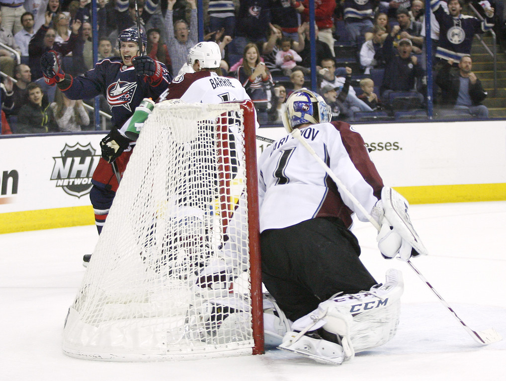 . Columbus Blue Jackets\' Blake Comeau (14), left, celebrates after scoring on Colorado Avalanche goalie Semyon Varlamov (1), of Russia, to make the score 2-0 during the second period of an NHL hockey game, Tuesday, April 1, 2014, in Columbus, Ohio. (AP Photo/Mike Munden)