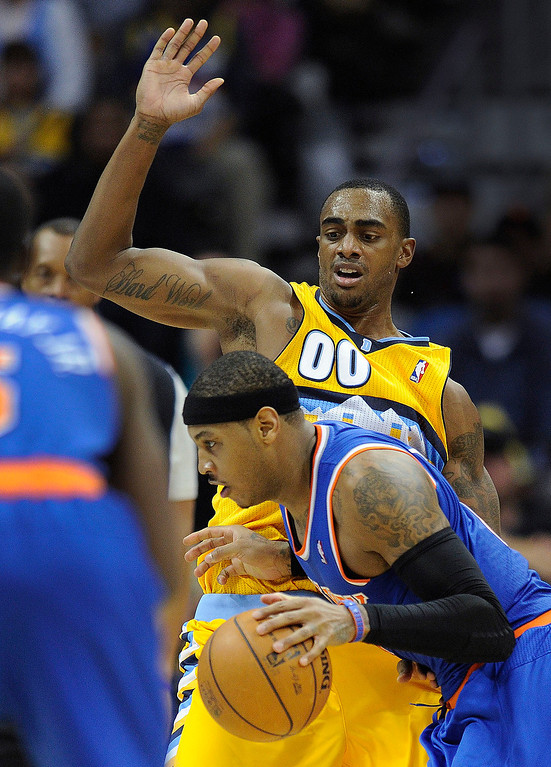 . New York forward Carmelo Anthony made a move past Denver forward Darrel Arthur in the second half.     Photo By Karl Gehring/The Denver Post