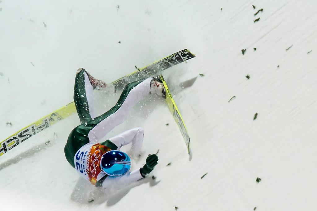 . Robert Kranjec of Slovenia crashes during the Men\'s Normal Hill Individual Qualification Round in Russki Gorki Jumping Center at the Sochi 2014 Olympic Games, Krasnaya Polyana, Russia, 08 February 2014.  EPA/JEAN-CHRISTOPHE BOTT