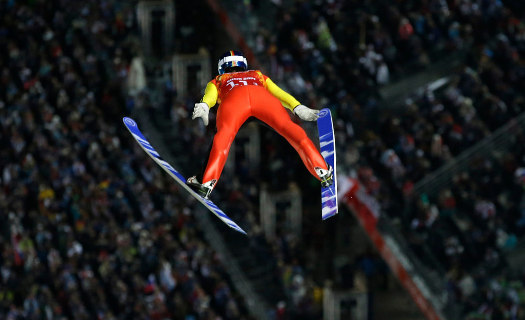 . Germany\'s Andreas Wank makes an attempt during the ski jumping large hill team competition at the 2014 Winter Olympics, Monday, Feb. 17, 2014, in Krasnaya Polyana, Russia. (AP Photo/Gregorio Borgia)