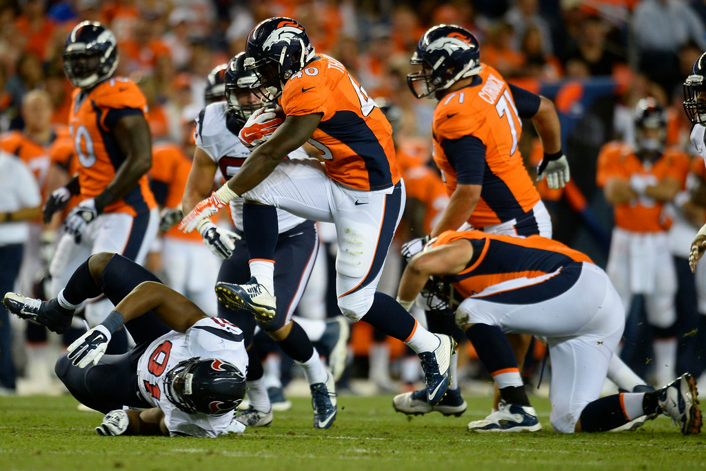 . DENVER, CO - AUGUST 23:  Juwan Thompson (40) of the Denver Broncos carries the ball against the Houston Texans during a preseason football game at Sports Authority Field at Mile High on Saturday, August 23, 2014 in Denver, Colorado.  (Photo by Kent Nishimura/The Denver Post)