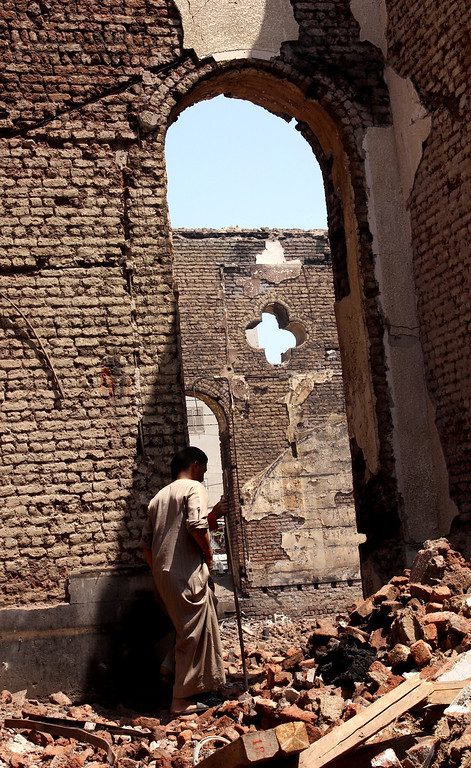 . An Egyptian walks in the ruins of the Evangelical Church of Malawi after it was ransacked, looted and burned on Thursday by an angry mob, in Malawi, south of Minya, Egypt, Saturday, Aug. 17, 2013. In the province of Minya south of Cairo, protesters attacked two Christian churches, security officials said. Many of Morsi\'s supporters have criticized Egypt\'s Christian minority for largely supporting the military\'s decision to remove him from office, and dozens of churches have been attacked this week. (AP Photo/Roger Anis, El Shorouk Newspaper)