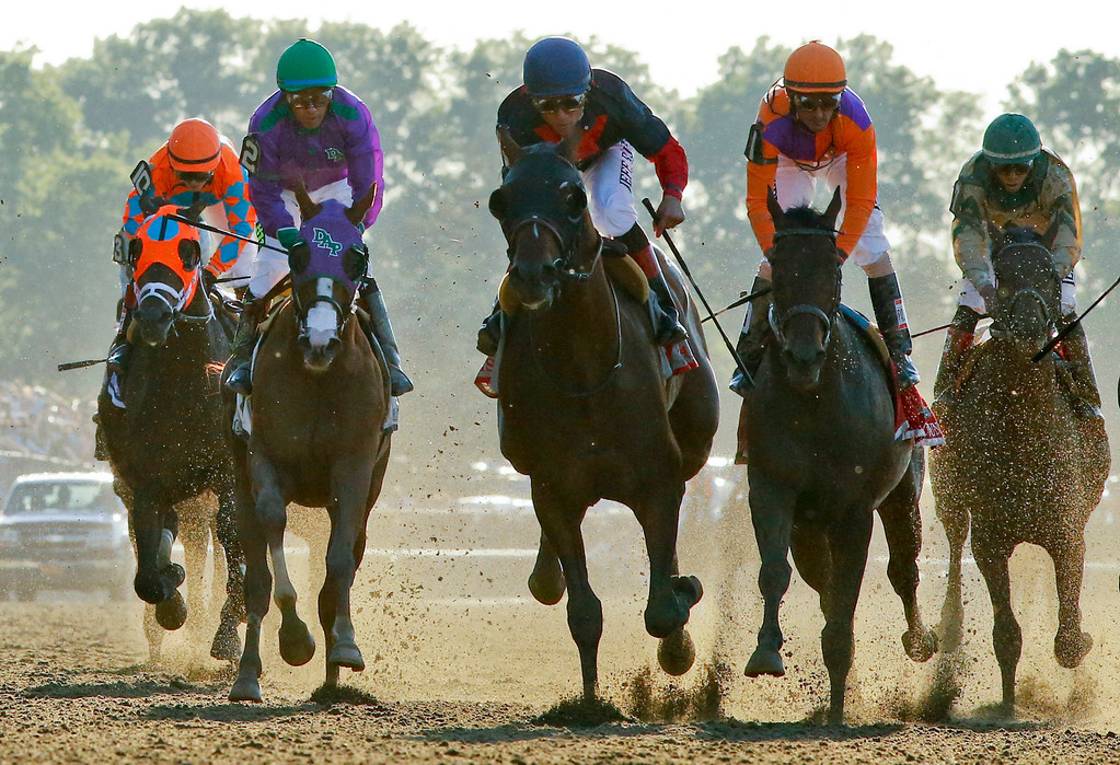 . Tonalist, center, with Joel Rosario up, approaches the finish line to win the Belmont Stakes horse race, Saturday, June 7, 2014, in Elmont, N.Y. Other horses are, from left, General a Rod (10), California Chrome (2), Medal Count (1), and Samraat. (AP Photo/Matt Slocum)