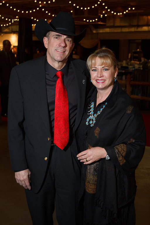 . Wayne and Susan Bichel.  Susan is wearing a vintage turquoise and silver necklace that Wayne\'s father found in Arizona for his mother about 40 years ago.  The 2013 Coors Western Art Exhibit and Sale Red Carpet Reception at the National Western Stock Show Complex in Denver, Colorado, on Tuesday, Jan. 8, 2013. Photo Steve Peterson