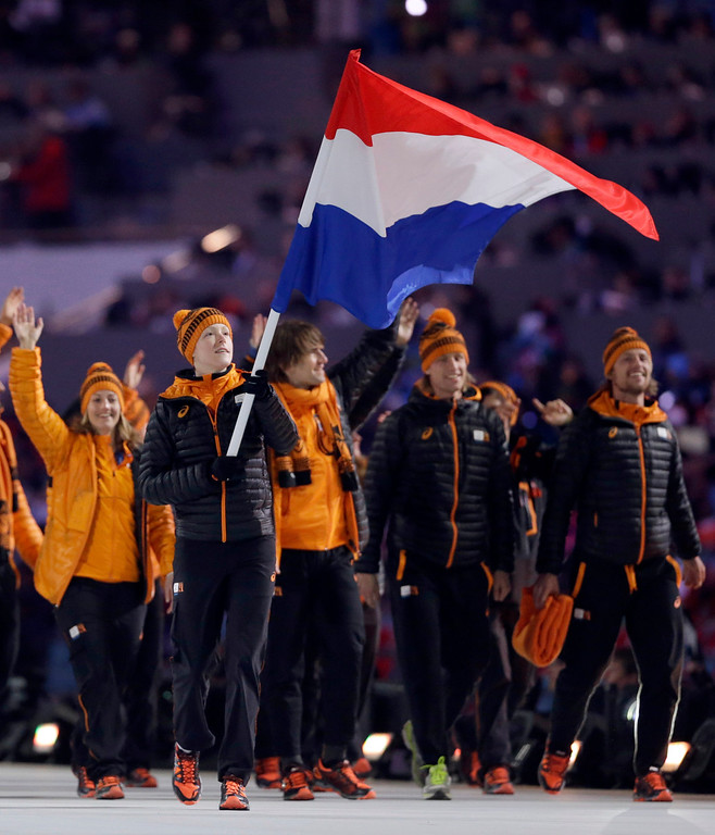 . Jorien ter Mors of Netherlands carries the national flag as he enters the stadium during the opening ceremony of the 2014 Winter Olympics in Sochi, Russia, Friday, Feb. 7, 2014. (AP Photo/Patrick Semansky)