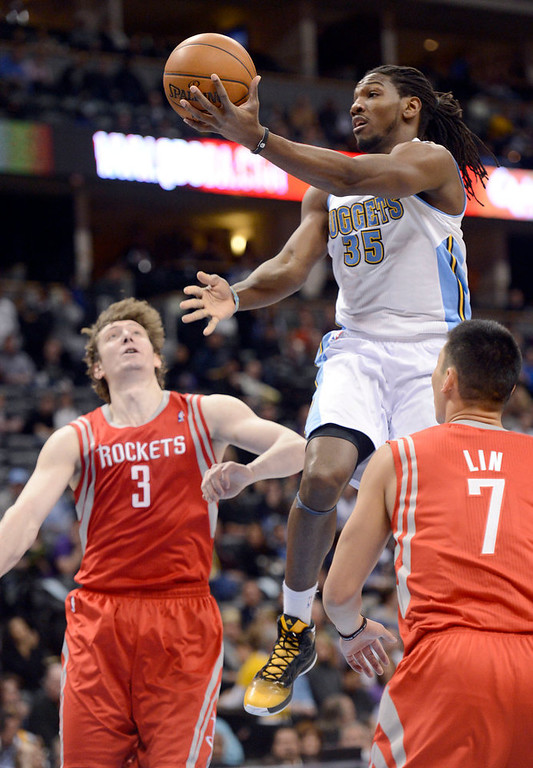 . DENVER, CO. - JANUARY 30: Denver Nuggets small forward Kenneth Faried (35) drives past Houston Rockets center Omer Asik (3) and Jeremy Lin during the first quarter January 30, 2013 at Pepsi Center. The Denver Nuggets take on the Houston Rockets in NBA action. (Photo By John Leyba/The Denver Post)