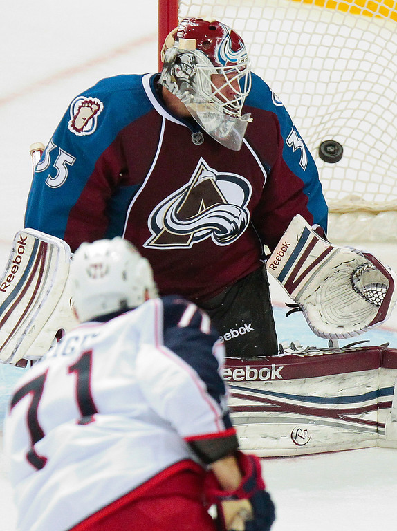 . Colorado Avalanche goalie Jean-Sebastien Giguere (35) watches the winning goal fly by, shot by Columbus Blue Jackets\' Nick Foligno (71), during the overtime of an NHL hockey game on Monday, April 15, 2013 in Denver. The Blue Jackets won 4-3 in Overtime. (AP Photo/Barry Gutierrez)