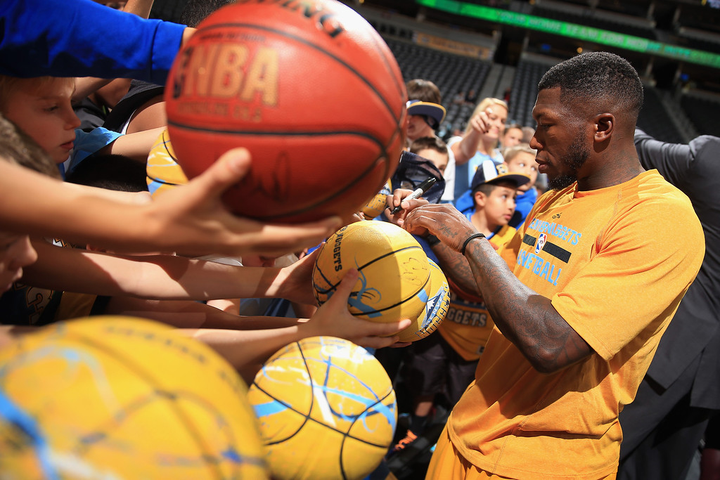 . DENVER, CO - NOVEMBER 15:  Nate Robinson #10 of the Denver Nuggets signs autographs prior to facing the Minnesota Timberwolves at Pepsi Center on November 15, 2013 in Denver, Colorado. (Photo by Doug Pensinger/Getty Images)