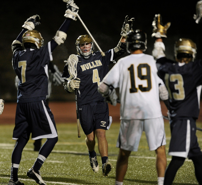. LITTLETON, CO. - APRIL 10: Mullen senior middie Brad Hale (4) celebrated his goal in the third quarter. The Mullen High School boy\'s lacrosse team defeated Arapahoe 8-7 Wednesday night, April 10, 2013. Photo By Karl Gehring/The Denver Post)