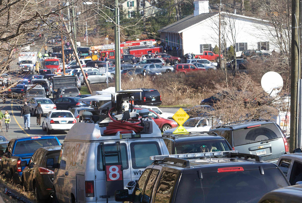 . The scene at Sandy Hook Elementary School in Newtown, Connecticut, December 14, 2012. A shooter opened fire at the elementary school in Newtown, Connecticut, on Friday, killing several people including children, the Hartford Courant newspaper reported. REUTERS/Michelle McLoughlin