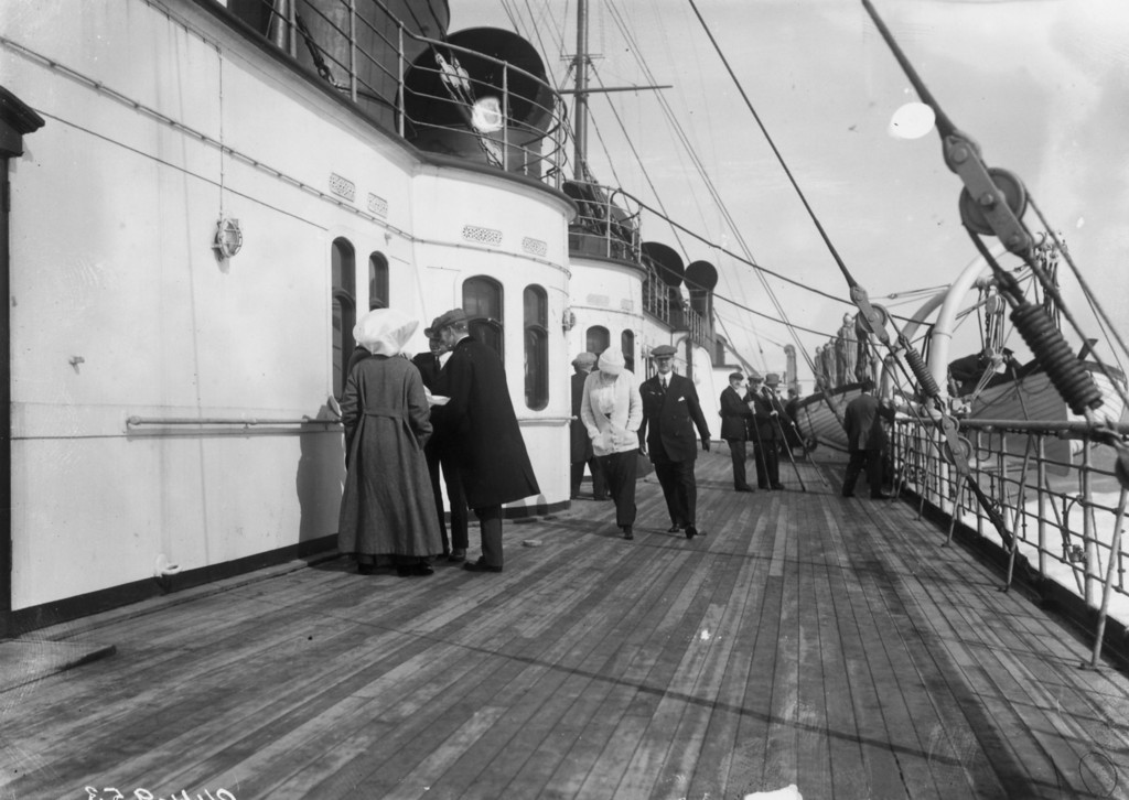 . June 1912:  Passengers on the promenade deck of the RMS Lusitania.  (Photo by Topical Press Agency/Getty Images)