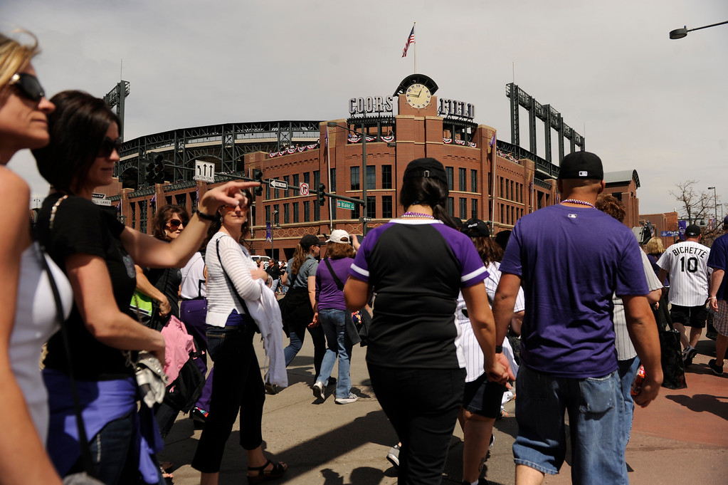 . Fans file towards the gates of Coors Field before the start of the game. (Photo by Karl Gehring/The Denver Post)