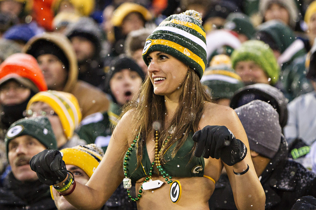 . A Fan of the Green Bay Packers dances in the snow in her bathing suit during a game against the Pittsburgh Steelers at Lambeau Field on December 22, 2013 in Green Bay, Wisconsin.  (Photo by Wesley Hitt/Getty Images)