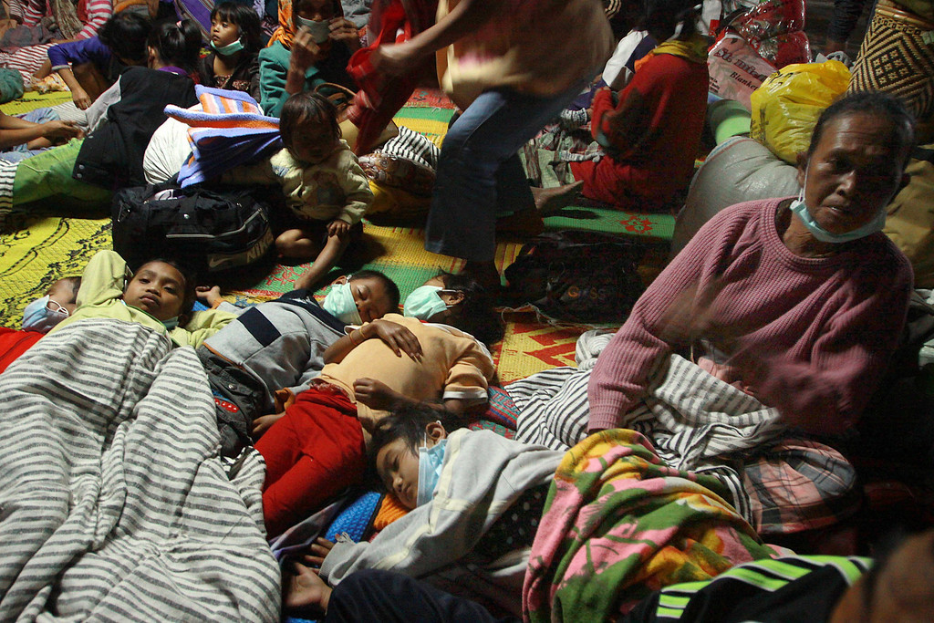. Displaced residents rest in an evacuation shelter in Karo district on Sumatra island on November 4, 2013 as Mount Sinabung volcano in western Indonesia erupted twice on November 3 hurling red-hot ash and rocks up to seven kilometers into the air and forcing more than 1,000 people to flee their homes. Mount Sinabung on Sumatra island erupted in September for the first time in three years, forcing thousands to flee their homes, and has been erupting intermittently ever since. AFP PHOTO / KHARISMA  TARIGAN/AFP/Getty Images