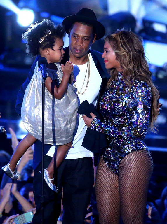 . Rapper Jay Z and singer Beyonce with daughter Blue Ivy Carter onstage during the 2014 MTV Video Music Awards at The Forum on August 24, 2014 in Inglewood, California.  (Photo by Mark Davis/Getty Images)