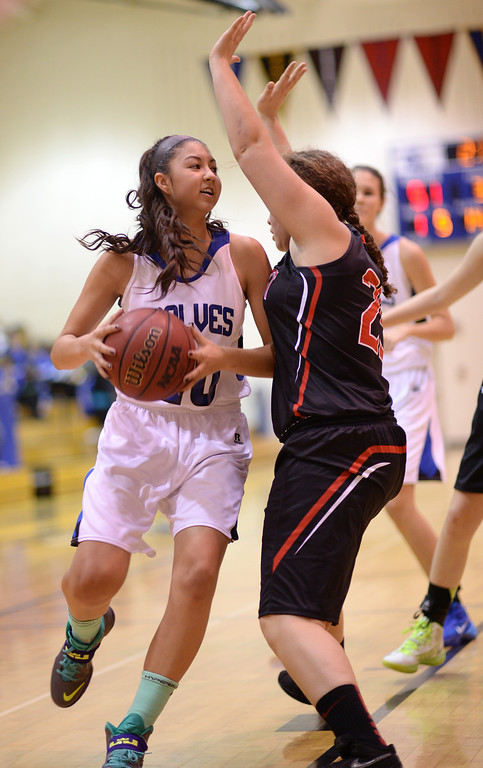 . AURORA, CO. JANUARY 08: Natalie Halbleib of Grandview High School (20), left, controls the ball against Qiqi Brockman of Eaglecrest High School (25) in the 2nd half of the game at Grandview High School in Aurora, Colorado January 8, 2014. Grandview won 69-22. (Photo by Hyoung Chang/The Denver Post)