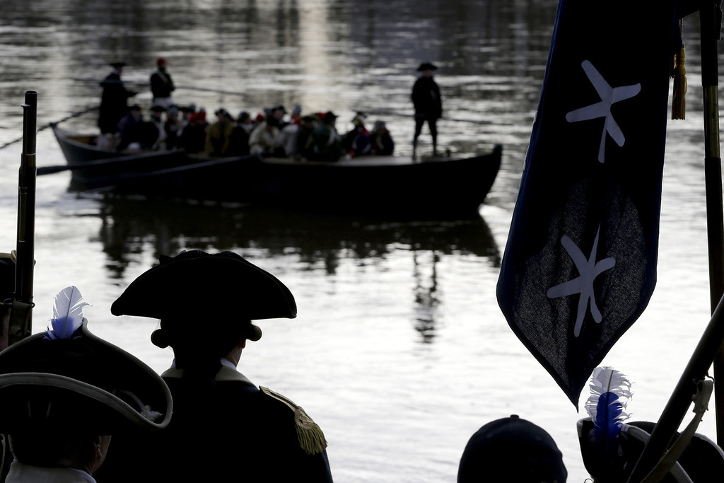 . A boat chugs along the Delaware River on its way from Pennsylvania to New Jersey during the 61st annual re-enactment of Washington\'s daring Christmas 1776 crossing of the river, the trek that turned the tide of the Revolutionary War, in Washington Crossing, N.J., on Wednesday, Dec. 25, 2013. During the crossing 237 years ago, boats ferried 2,400 soldiers, 200 horses and 18 cannons across the river, and the troops marched eight miles downriver before battling Hessian mercenaries in the streets of Trenton. (AP Photo/Julio Cortez)