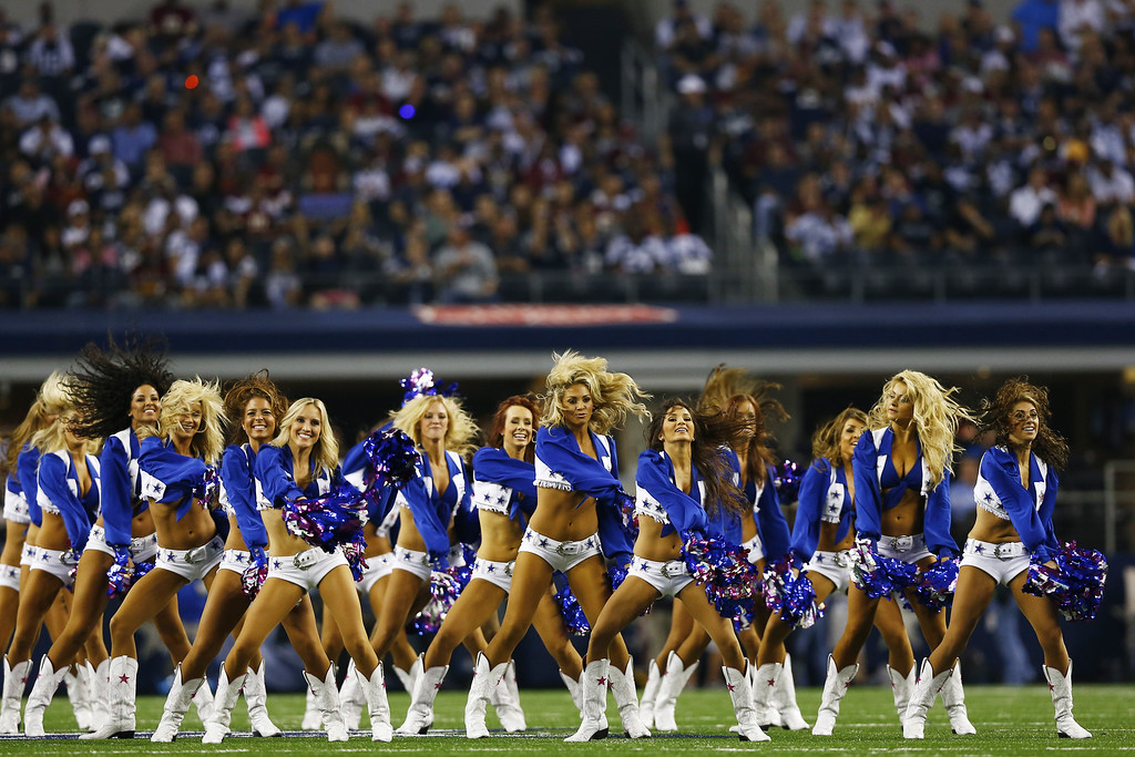 . ARLINGTON, TX - OCTOBER 13:  The Dallas Cowboys cheerleaders perform during a game against the Washington Redskins at AT&T Stadium on October 13, 2013 in Arlington, Texas.  (Photo by Tom Pennington/Getty Images)