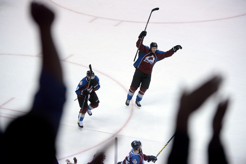 . DENVER, CO - APRIL 26: P.A. Parenteau (15) of the Colorado Avalanche (bottom center) celebrates his game-tying 3-3 goal as teammates Nathan MacKinnon (29) and Erik Johnson (6) join in during the third period. The Colorado Avalanche hosted the Minnesota Wild during game five of the first round of the NHL Stanley Cup Playoffs at the Pepsi Center on Saturday, April 26, 2014. (Photo by Karl Gehring/The Denver Post)