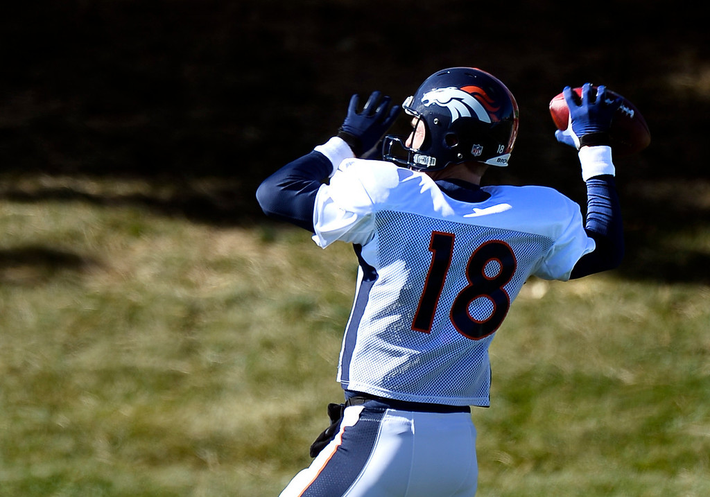 . Denver Broncos quarterback Peyton Manning (18) throws a pass during practice November 6, 2013 at Dove Valley. (Photo by John Leyba/The Denver Post)