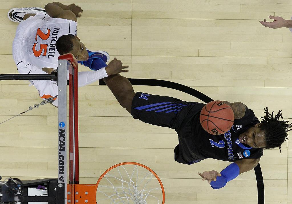 . Memphis forward Shaq Goodwin (2) shoots against Virginia forward Akil Mitchell (25) during the first half of an NCAA college basketball third-round tournament game, Sunday, March 23, 2014, in Raleigh. (AP Photo/Chuck Burton)